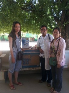 Ramya Moang presenting Dr Nourn Sophat and Midwife with a refrigerator for the Maternity area.