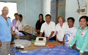 Presenting Dr Sophat, Medical Director, with Electro Cardiograph Machine.